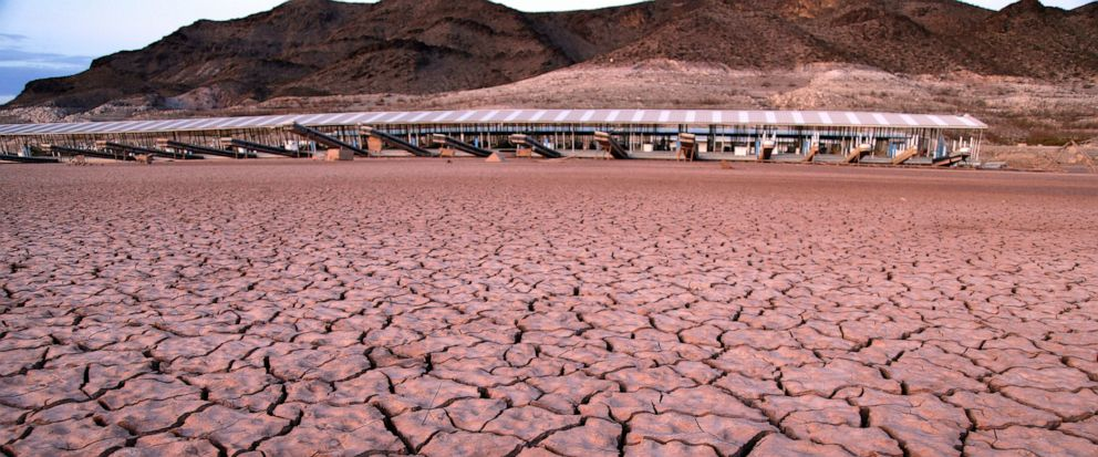 FILE - In this July 16, 2014 file photo, what was once a marina sits high and dry due to Lake Mead receding in the Lake Mead National Recreation Area in Arizona. Extreme swings in weather are expected as part of a changing climate, something Brad Uda