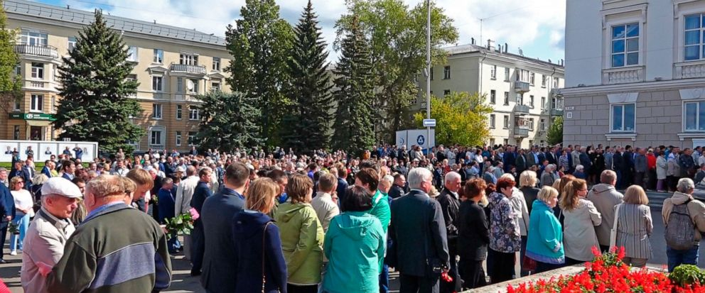 In this grab taken from a footage provided by the Russian State Atomic Energy Corporation ROSATOM press service, people gather for the funerals of five Russian nuclear engineers killed by a rocket explosion in Sarov, the closed city, located 370 kilo