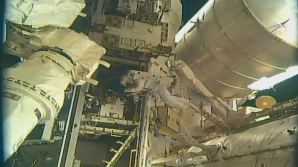 Spacewalking astronauts add parking spot to space station