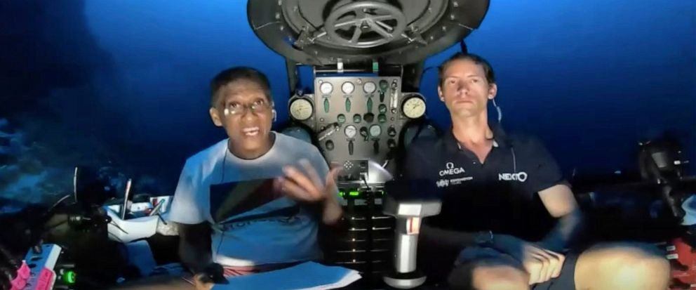 An image taken from video issued by Nekton shows Seychelles President Danny Faure, left, speaking from inside a submersible from the vessel Ocean Zephyr, under the water off the coast of Desroches, in the outer islands of Seychelles Sunday April 14,