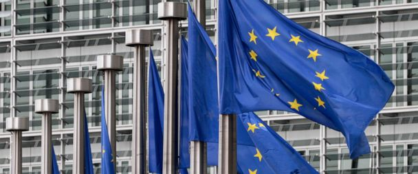 FILE - In this May 9, 2011 file photo, EU flags fly outside the European Commission headquarters in Brussels. Disinformation has evolved beyond the playbook used by Russian trolls in the U.S. election. As the European Union gears up for a crucial ele