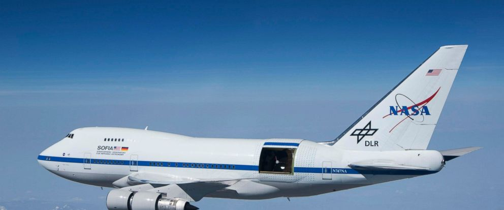 This undated photo provided by NASA shows SOFIA over the snow-covered Sierra Nevada mountains with its telescope door open during a test flight. The worlds largest airborne observatory was supposed to be parked in Seattle this week, so thousands of