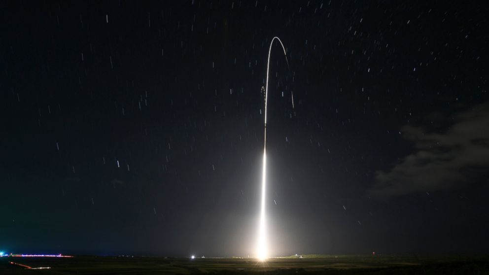 FILE - This Dec. 10, 2018, file photo, provided by the U.S. Missile Defense Agency (MDA),shows the launch of the U.S. military's land-based Aegis missile defense testing system, that later intercepted an intermediate range ballistic missile, from the Pacific Missile Range Facility on the island of Kauai in Hawaii. The Trump administration will roll out a new strategy Thursday, Jan. 17, 2019, for a more aggressive space-based missile defense system to protect against existing threats from North Korea and Iran and counter advanced weapon systems being developed by Russia and China. (Mark Wright/Missile Defense Agency via AP)