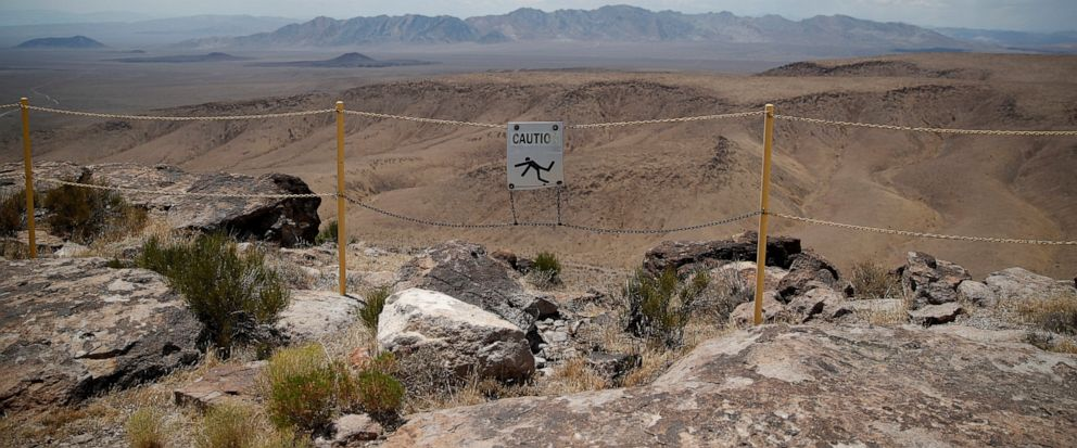 FILE - In this July 14, 2018, file photo, a sign warns of a falling danger on the crest of Yucca Mountain during a congressional tour near Mercury, Nev. Recent California earthquakes that rattled Las Vegas have shaken up arguments by proponents and o