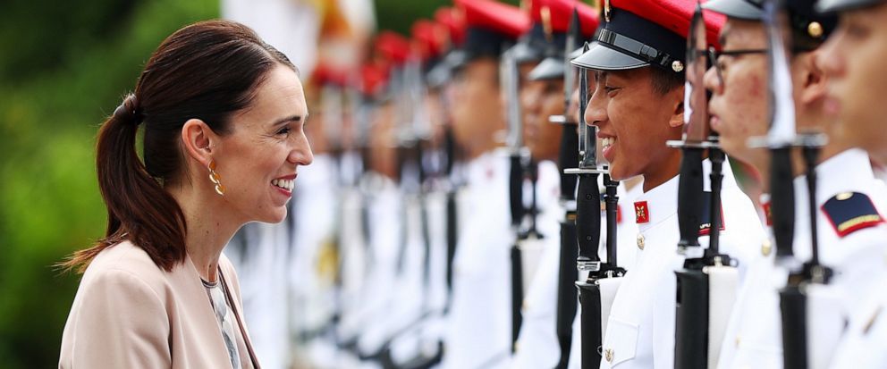 New Zealands Prime Minister Jacinda Ardern speaks with a member of the honor guard during a welcome ceremony at the Istana or presidential palace in Singapore, Friday, May 17, 2019. (AP Photo/Yong Teck Lim)
