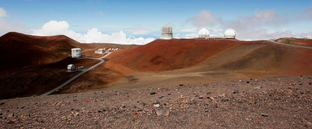 FILE - In this Aug. 31, 2015, file photo, observatories and telescopes sit atop Mauna Kea, Hawaiis tallest mountain and the proposed construction site for a new $1.4 billion telescope, near Hilo, Hawaii. Construction on a giant telescope will start