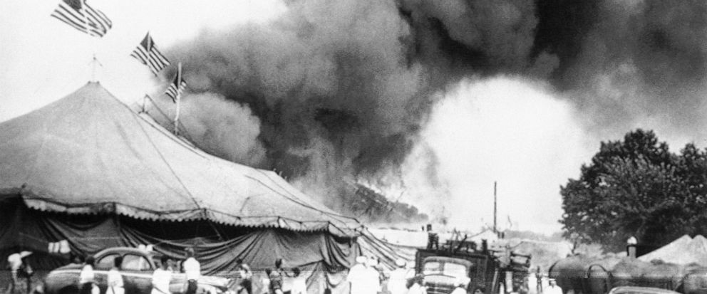 FILE - In this July 6, 1944 file photo people flee a fire in the big top of the Ringling Brothers and Barnum and Bailey Circus in Hartford. Conn. Authorities are exhuming the bodies of two victims of the 1944 circus fire in hopes of identifying a Ver