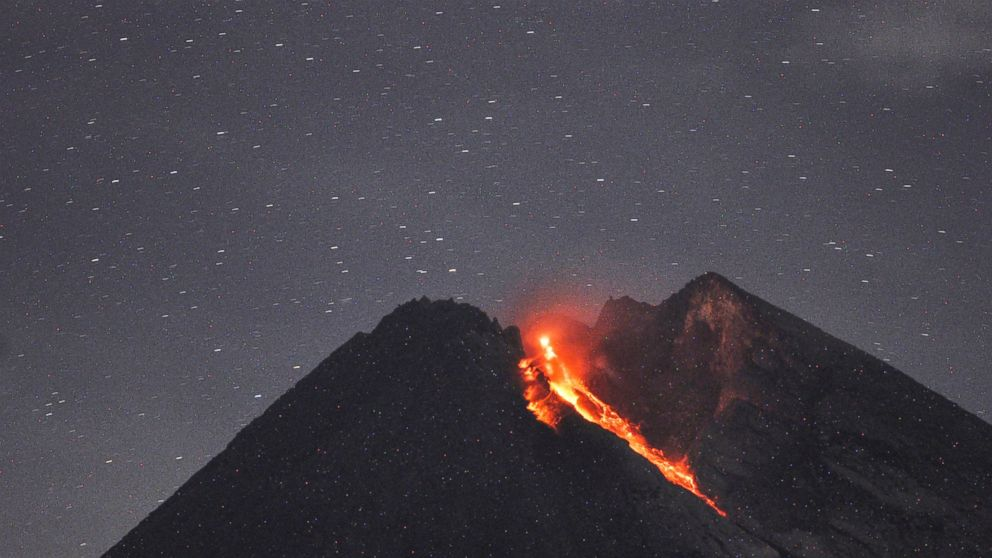 In this Tuesday, Jan, 29, 2019, photo. Mount Merapi spews volcanic material as it erupts as seen from Cangkringan, Yogyakarta, Indonesia. Indonesia's most volatile volcano unleashed a 1,400 meters (4,600 feet) dark red volcanic material 1,400 meters (1,500 yards) down the slopes. (AP Photo/Slamet Riyadi)