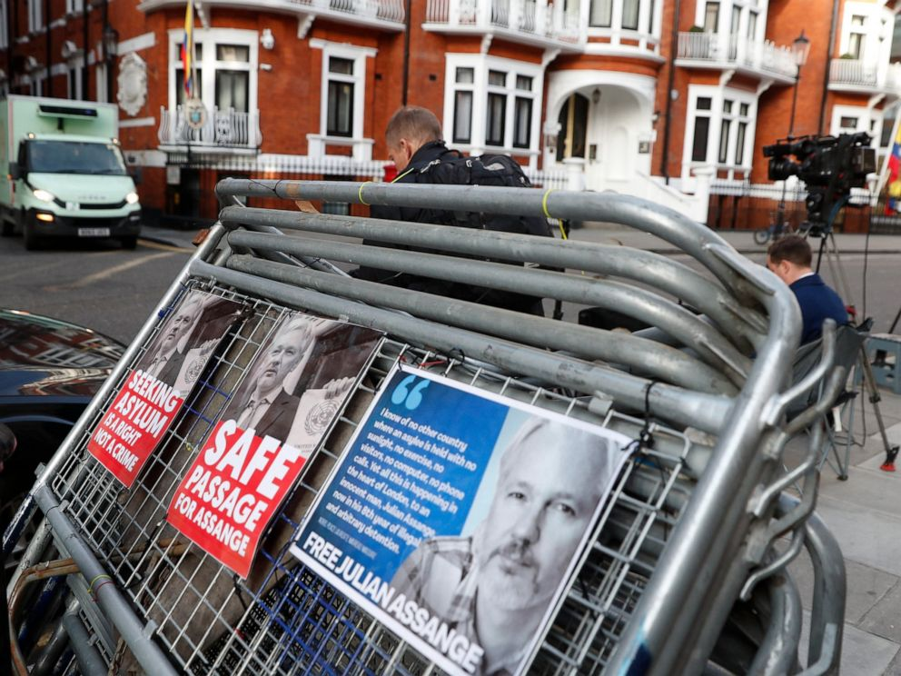 Placards on a crowd barriers outside the Ecuadorian Embassy in London, Friday, April 5, 2019, where Wikileaks founder Julian Assange has been holed up since 2012. A senior Ecuadorian official said no decision has been made to expel Julian Assange fro