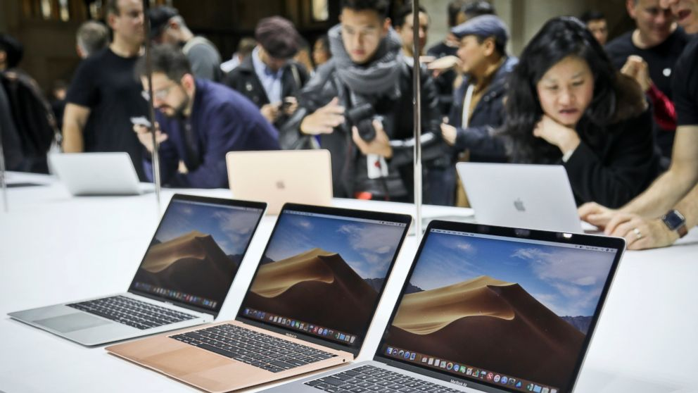 FILE- In this Oct. 30, 2018, file photo Apple's new MacBook Air computers are displayed during the company's showcase of new products in the Brooklyn borough of New York. Apple Inc. reports earnings Tuesday, Jan. 29, 2019. (AP Photo/Bebeto Matthews, File)