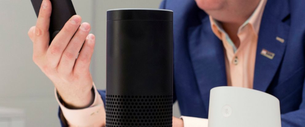 FILE - In this June 14, 2018, photo, an Amazon Echo, center, and a Google Home, right, are displayed in New York. Google contractors are listening to some recordings of people talking to Assistant, either on their phone or through smart speakers such