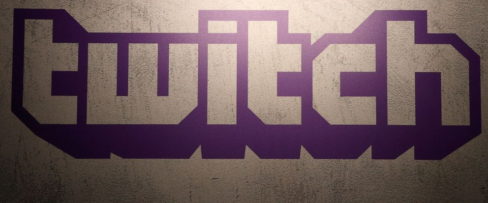 FILE - This Saturday, Nov. 4, 2017, file photo shows the logo of live streaming video platform Twitch at the Paris games week in Paris. The attacker who killed two people in a shooting at a German synagogue live-streamed his assault on Twitch, a vide