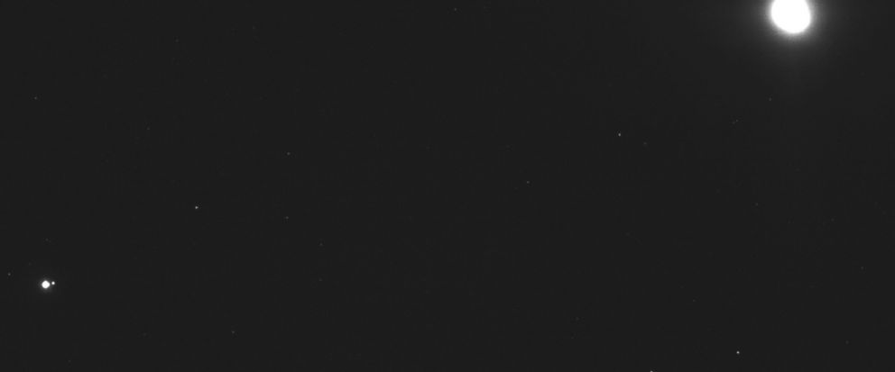 This image captured on Dec. 19, 2018, by a camera on the Osiris-Rex spacecraft shows the asteroid Bennu, top right, about 27 miles (43 kilometers) from the spacecraft, and the Earth and moon, bottom left, more than 70 million miles (110 million kilom