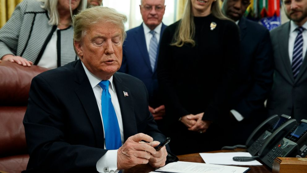 """President Donald Trump pauses during a signing event for """"Space Policy Directive 4"""" in the Oval Office of the White House, Tuesday, Feb. 19, 2019, in Washington. (AP Photo/ Evan Vucci)"""