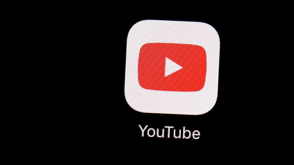 FILE - This March 20, 2018 file photo shows the YouTube app on an iPad in Baltimore. Several companies, including AT&T and Nestle, are pulling advertisements from YouTube over concerns about inappropriate comments on videos of children. (AP Photo/Patrick Semansky, File)
