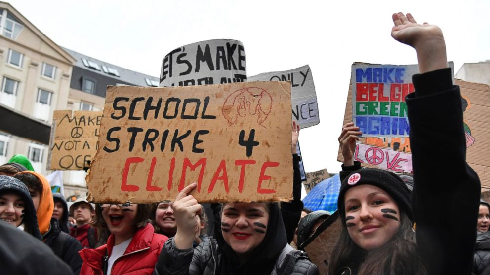 Students and others hold up placards with climate messages during a demonstration against climate change in Brussels, Thursday, Jan. 17, 2019. Thousands of students as part of the Youth for Climate movement took time off school Thursday to call for stronger action against climate change. (AP Photo/Geert Vanden Wijngaert)