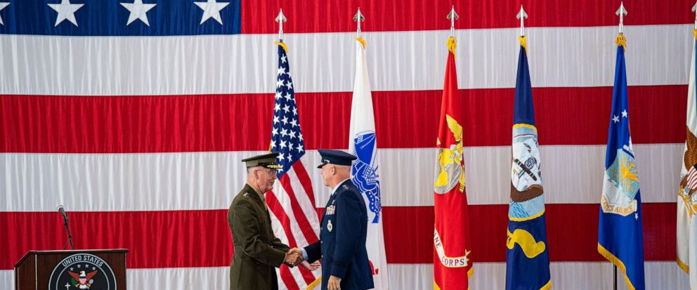 Joint Chiefs of Staff Gen. Joseph F. Dunford, Jr., left, shakes hands with Gen. John W. Raymond, the commander of the U.S. Space Command, Sept. 9, 2019, during a ceremony to recognize the establishment of the United States Space Command at Peterson A
