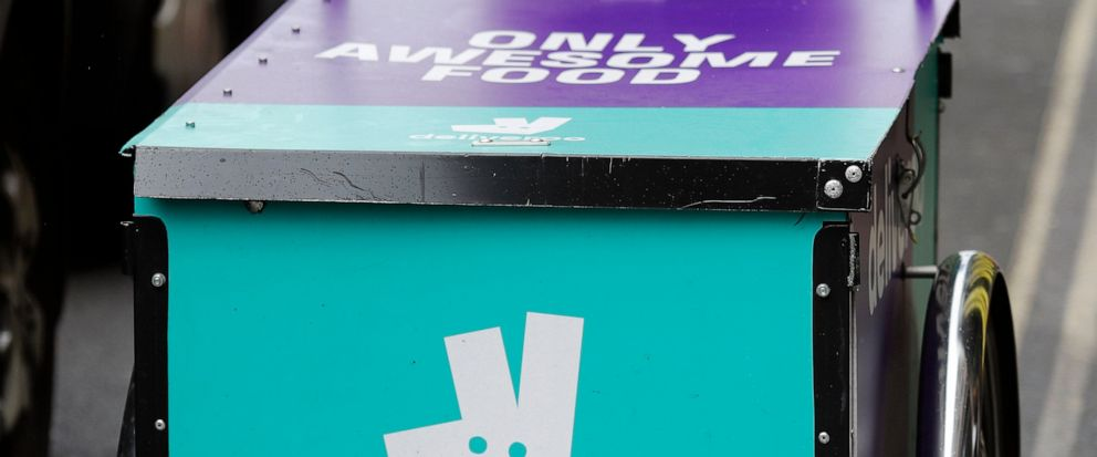 FILE - In this file photo dated Tuesday, July 11, 2017, a Deliveroo logo on a bicycle in London. The U.K. competition watchdog has launched an investigation into Amazon's purchase of a significant stake in food delivery service Deliveroo on Friday Ju