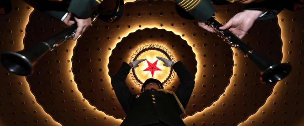 A military band conductor rehearses the band before the closing session of the National Peoples Congress in Beijings Great Hall of the People on Friday, March 15, 2019. (AP Photo/Ng Han Guan)