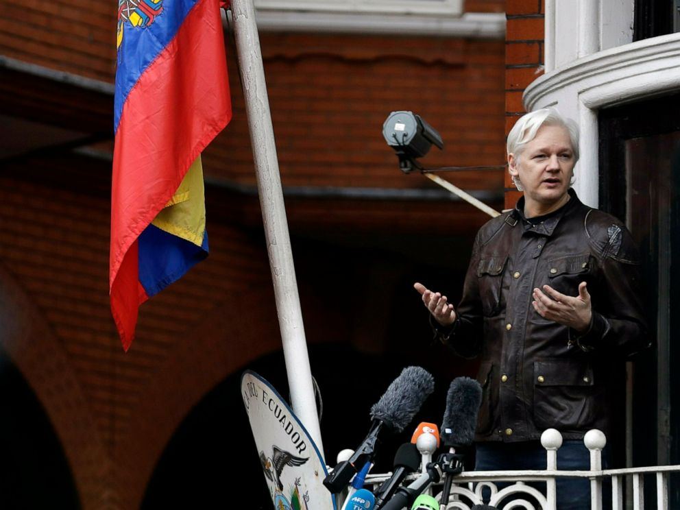FILE - In this Friday May 19, 2017 file photo, WikiLeaks founder Julian Assange gestures as he speaks on the balcony of the Ecuadorian embassy, in London. A senior Ecuadorian official said no decision has been made to expel Julian Assange from the co