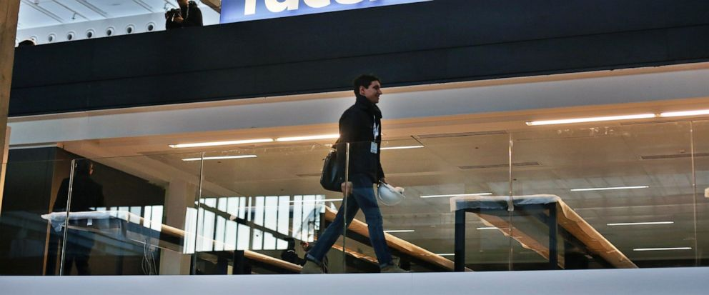 FILE - In this Jan. 17, 2017, file photo, the Facebook logo is displayed in a start-up companies gathering at Paris Station F. The White House is launching an investigation into France's proposed tax on internet giants like Google, Amazon and Facebo