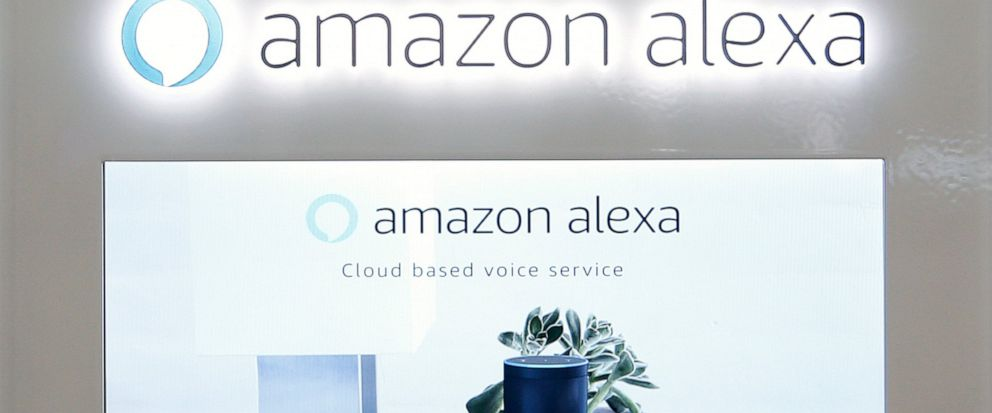 FILE - In this Monday, Aug. 7, 2017 file photo, an Amazon Alexa display is seen at a store in Hialeah, Fla. Britain's health agency is teaming up with Amazon's digital voice assistant to help answer medical queries with advice from the agency's offic