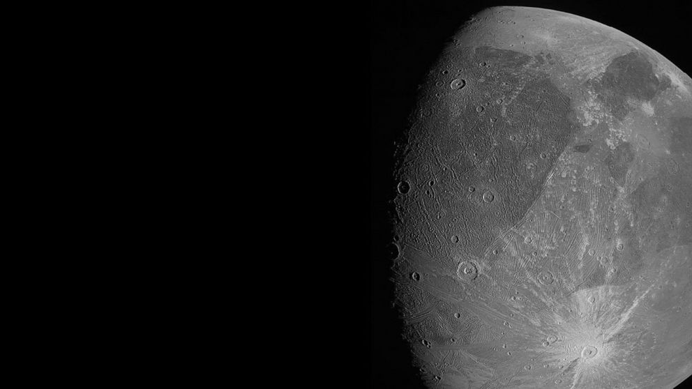 """This June 7, 2021 image made available by NASA shows the Jovian moon Ganymede as the Juno spacecraft flies by. """"This is the closest any spacecraft has come to this mammoth moon in a generation,"""" said Juno's lead scientist, Scott Bolton of the Southwe"""