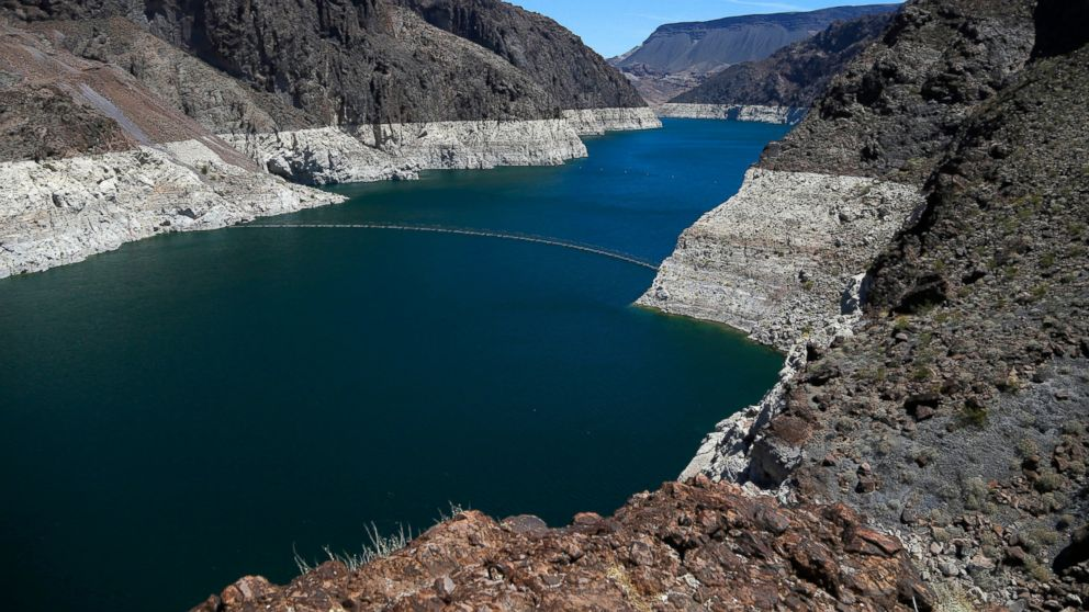 FILE - This May 31, 2018 file photo shows the reduced water level of Lake Mead behind Hoover Dam in Arizona. Arizona is nearing a deadline to approve a plan to ensure a key reservoir in the West doesn't become unusable as a water source for farmers, cities, tribes and developers. Other Western states are watching. The U.S. Bureau of Reclamation expects full agreement on a drought contingency plan by Thursday, Jan. 31, 2019. (AP Photo/Ross D. Franklin, File)