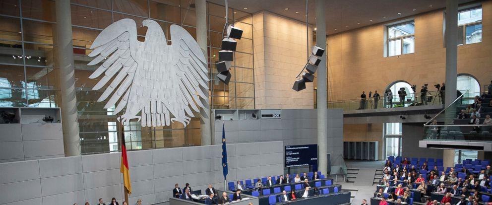 FILE---In this picture taken Nov.21, 2018 German Chancellor Angela Merkel (CDU) speaks in the Bundestag. (Ralf Hirschberger/dpa via AP)