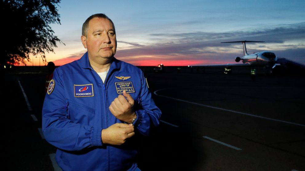 FILE - In this Thursday, Oct. 11, 2018 file photo, Director General of the Russia state corporation Roscosmos Dmitry Rogozin walks in Baikonur airport, in Kazakhstan. Russia's space agency is complaining that the invitation for its head to visit the U.S. has been cancelled without informing the organization. NASA Administrator Jim Bridenstine has told The Washington Post on Sunday, Jan. 6, 2019 that he has rescinded the invitation to Roscosmos head Dmitry Rogozin after several senators raised complaints. (Yuri Kochetkov/Pool Photo via AP, file)
