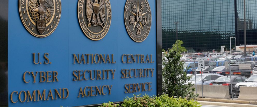 FILE - In this June 6, 2013 file photo, the sign outside the National Security Administration (NSA) campus in Fort Meade, Md. A high-profile raid at the home of an NSA contractor seemed to be linked to the devastating leak of U.S. government hacking