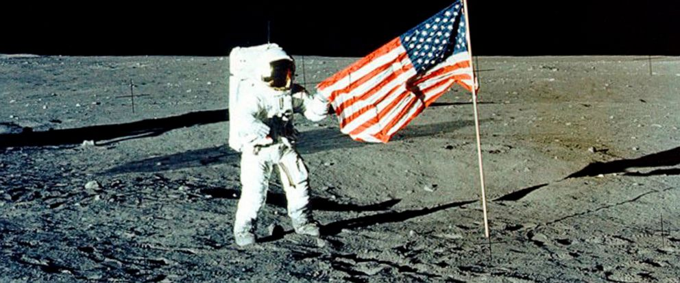 """FILE - In this November 1969 photo provided by NASA, Apollo 12 mission Commander Charles P. """"Pete"""" Conrad stands on the moons surface. He was the third man to walk on the moon. On Tuesday, May 14, 2019, NASAs chief says the Trump administrations p"""