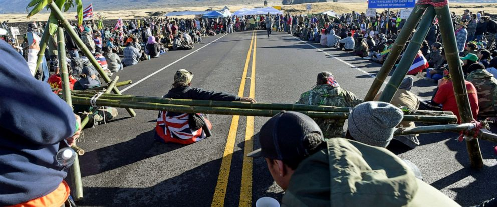 FILE - In this July 19, 2019, file photo, protesters continue their opposition vigil against the construction of the Thirty Meter Telescope at Mauna Kea on the Big Island of Hawaii. Astronomers across 11 observatories on Hawaii's tallest mountain hav