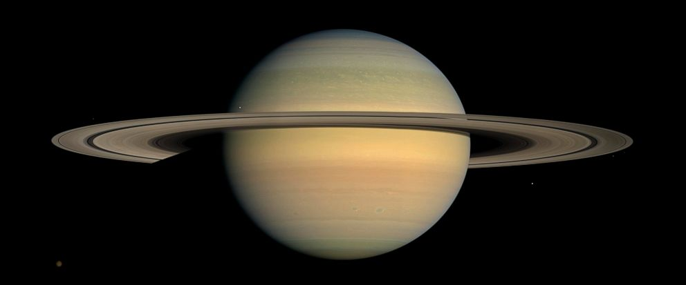 FILE - This July 23, 2008 file image made available by NASA shows the planet Saturn, as seen from the Cassini spacecraft. Twenty new moons have been found around Saturn, giving the ringed planet a total of 82, scientists said Monday, Oct. 7, 2019. (N