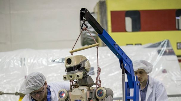 Russian capsule carrying robot docks at space station