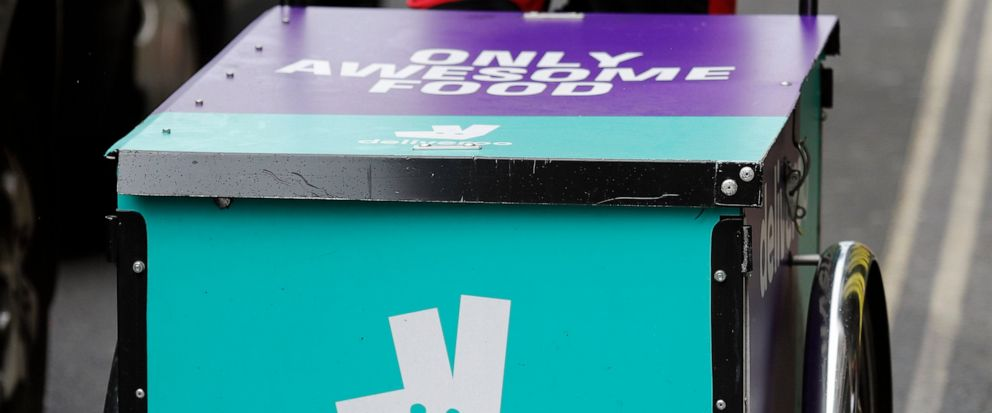 FILE - In this Tuesday, July 11, 2017 file photo, a Deliveroo logo is seen on a bicycle in London. Amazon is investing in British meal delivery company Deliveroo, expanding its reach into food retailing. Deliveroo said Friday May 17, 2019 that it rai