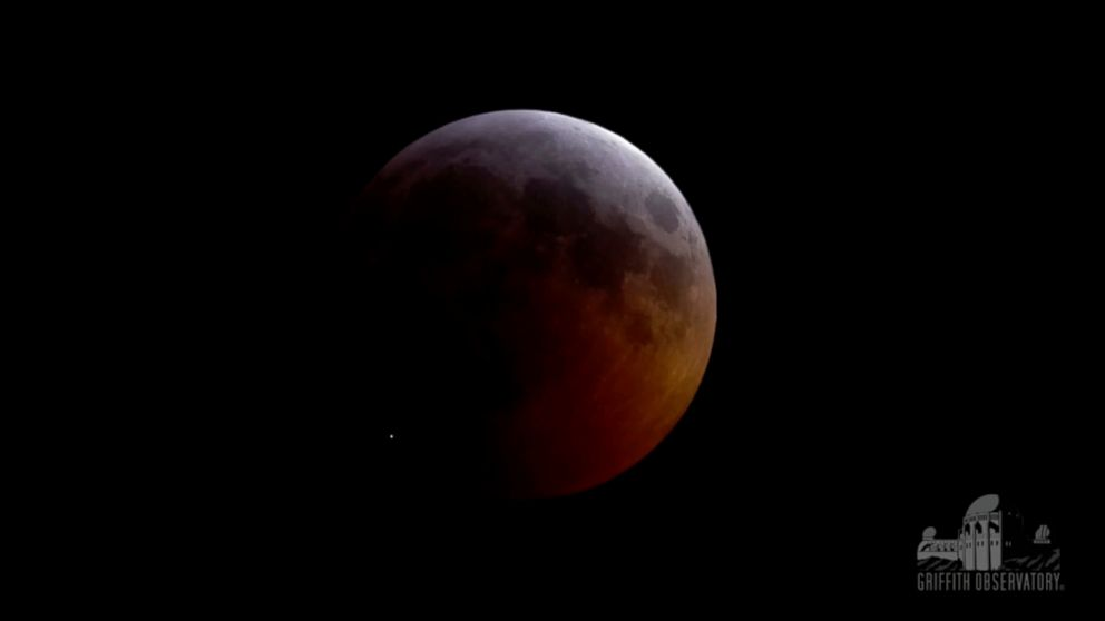 This image from video provided by Griffith Observatory in Los Angeles shows an impact flash on the moon, bottom left, during the lunar eclipse which started on Sunday evening, Jan. 20, 2019. Spanish astrophysicist Jose Maria Madiedo of the University of Huelva said Wednesday, Jan. 23, 2019, it appears a rock from a comet slammed into the moon. (Griffith Observatory via AP)