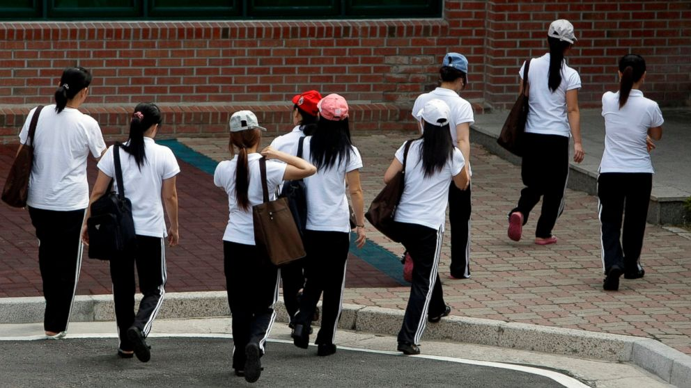 FILE - In this July 8, 2009, file photo, women who defected from North Korea walk for their class at the Hanawon, a state-run official shelter for North Korean defectors, in Ansung, South Korea. South Korea on Friday, Dec. 28, 2018, says it's responding to a cyber-hacking attack that stole the names and addresses of nearly 1,000 North Korean defectors who resettled in the South. (AP Photo/ Lee Jin-man, File)