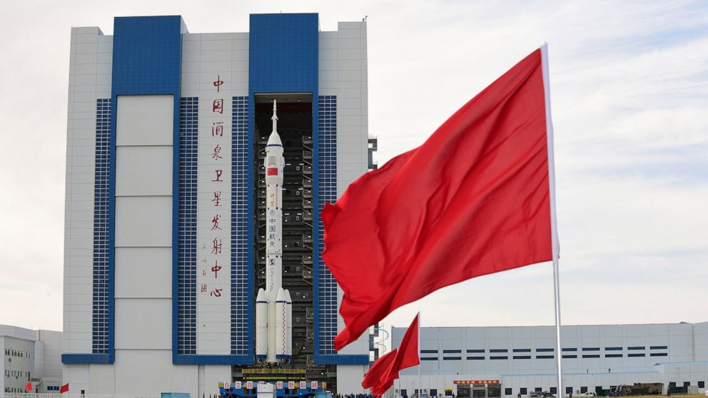 In this photo released by Xinhua News Agency, the Shenzhou-12 manned spaceship with its Long March-2F carrier rocket is being transferred to the launching area of Jiuquan Satellite Launch Center in northwestern China's Gansu province, on Wednesday, J