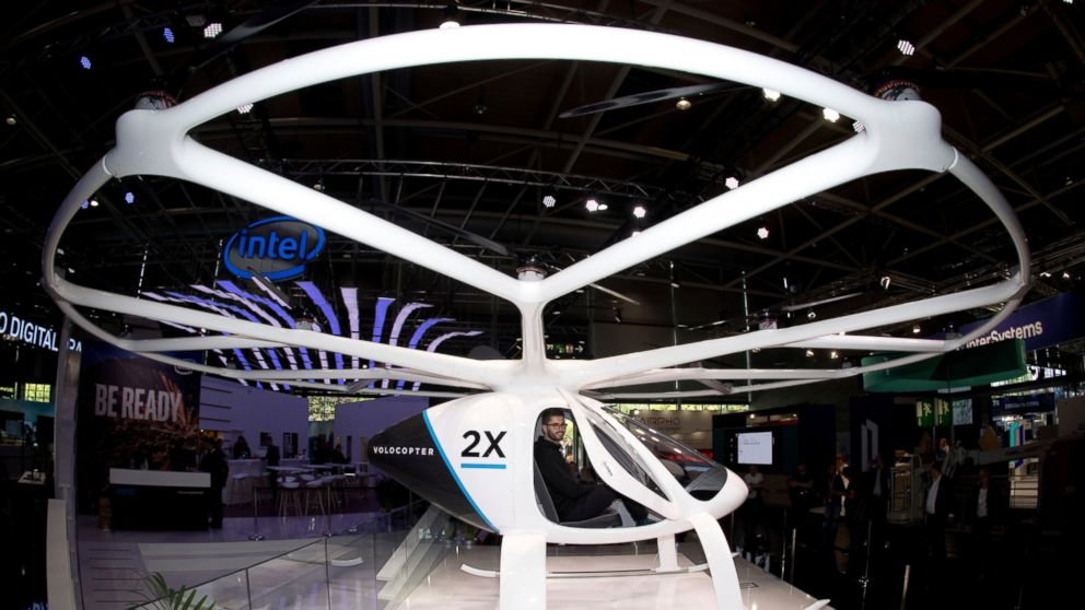FILE -In this Monday, June 11, 2018 file photo, the multi-rotor electric aircraft Volocopter 2x, displayed at the electronic fair Cebit in Hannover, Germany. The operator of Frankfurt's international airport is working on a concept for future autonomous air taxi services in cooperation with the Volocopter GmbH. ( Julian Stratenschulte/dpa via AP)