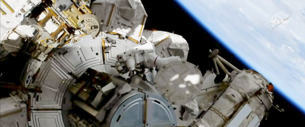 This image provided by NASA shows astronauts Andrew Morgan on a spacewalk outside the International Space Station on Friday, Oct. 11, 2019. Morgan and Christina Koch are replacing decade-old batteries in the station's solar power network with new and