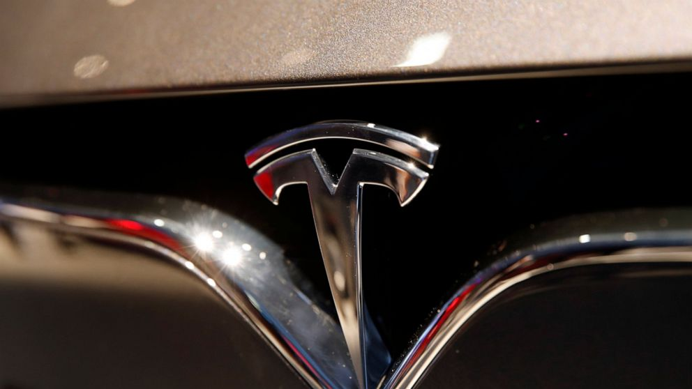 The Latest: Tesla to introduce new ride-hailing service