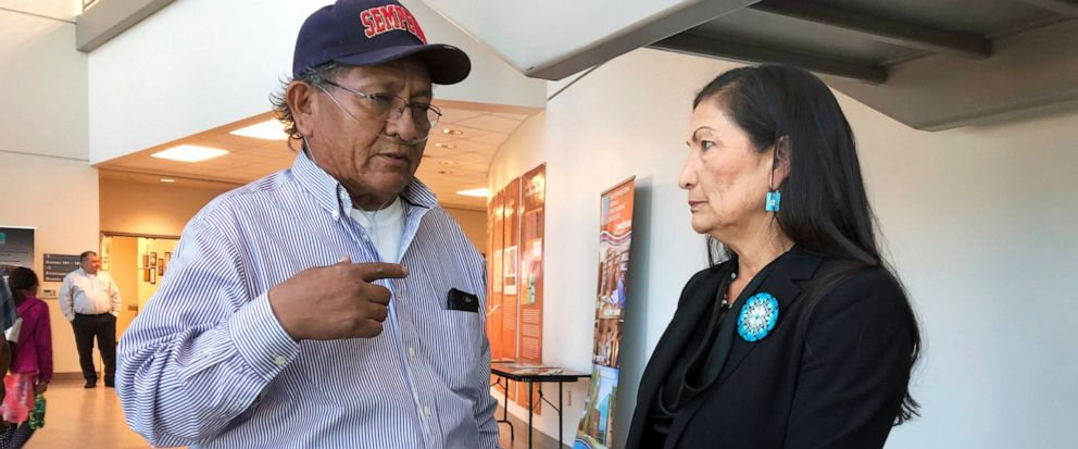 Leslie Begay, left, speaks with U.S. Rep. Deb Haaland, D-New Mexico, in a hallway outside a congressional field hearing in Albuquerque, N.M., highlighting the atomic ages impact on Native American communities on Monday, Oct. 7, 2019. Begay, a former