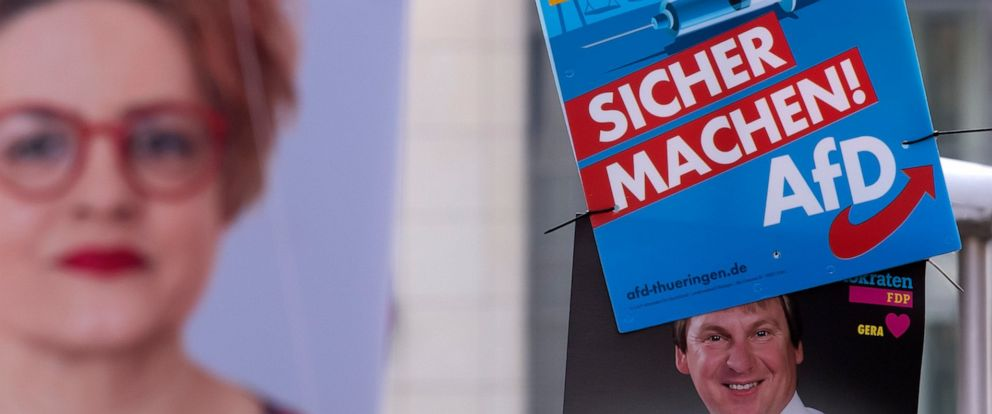 In this Friday, May 17, 2019 photo an AfD poster (top right) hangs on a street light during the street Europe and communal election campaigning of the far-right Alternative for Germany AfD in Gera, Germany. In Germany, the far-right AfD party is domi