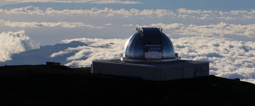 FILE - In this July 14, 2019, file photo, a telescope at the summit of Mauna Kea, Hawaiis tallest mountain is viewed. Astronomers across 11 observatories on Hawaii's tallest mountain have cancelled more than 2,000 hours of telescope viewing over the
