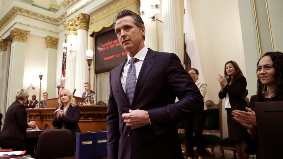 "In this Tuesday, Feb. 12, 2019 photo, California Gov. Gavin Newsom receives applause after delivering his first state of the state address to a joint session of the legislature at the Capitol in Sacramento, Calif. Newsom said the state's consumers should get a ""data dividend"" from technology companies, like Google and Facebook, who are make by capitalizing on the personal data they collect. (AP Photo/Rich Pedroncelli)"
