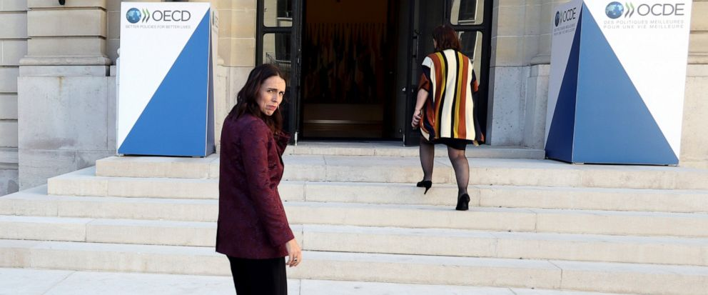 New Zealand Prime Minister Jacinda Ardern, left, leaves after a press conference, at the OECD headquarters, in Paris, Tuesday, May 14, 2019. The leaders of France and New Zealand will make a joint push to eliminate acts of violent extremism from bein