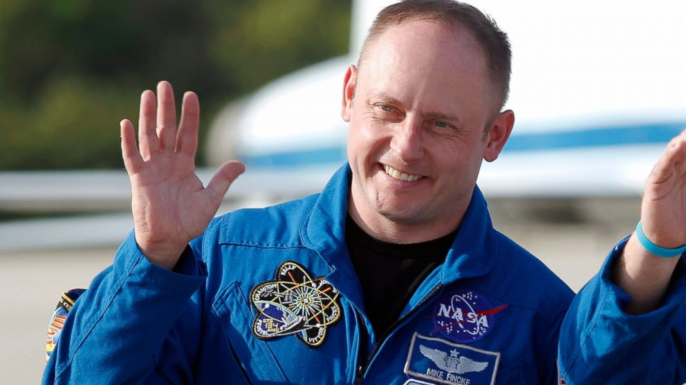 FILE - In this Tuesday, March 29, 2011 file photo, space shuttle Endeavour crew member Mike Fincke waves to onlookers after arriving for a practice countdown at Kennedy Space Center in Cape Canaveral, Fla. On Tuesday, Jan. 23, 2019, astronaut Eric Boe was pulled from the upcoming test flight for unspecified medical reasons, after more than three years of training. Taking his seat will be Fincke, a former space station commander. (AP Photo/Terry Renna)