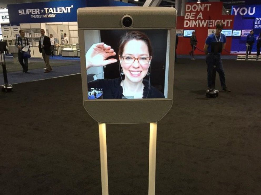 PHOTO: ABC News Neal Karlinsky talks to a woman who telecommutes out of state via this remote-controlled robot on wheels at CES 2015 on Jan. 7, 2015.