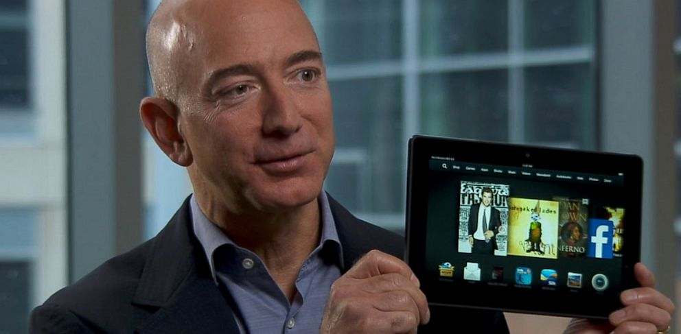 PHOTO: Jeff Bezos holds up the Kindle Fire HDX.